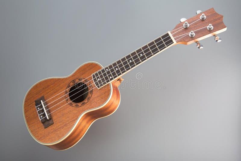 Ukulele guitar on gray background royalty free stock photo