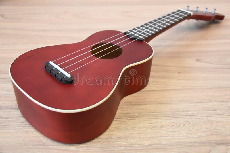Ukulele guitar , tenor mahagony ukulele. On wood background royalty free stock photography