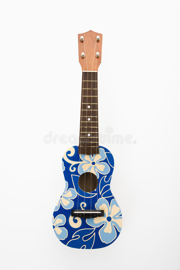 Ukulele mit blauen Blumen. lizenzfreies stockfoto