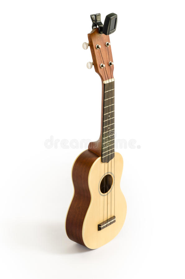 Ukulele and Tuner isolated on white Clipping path included : does not include shadow. Ukulele and Tuner isolated on white Clipping path included : does not royalty free stock photos