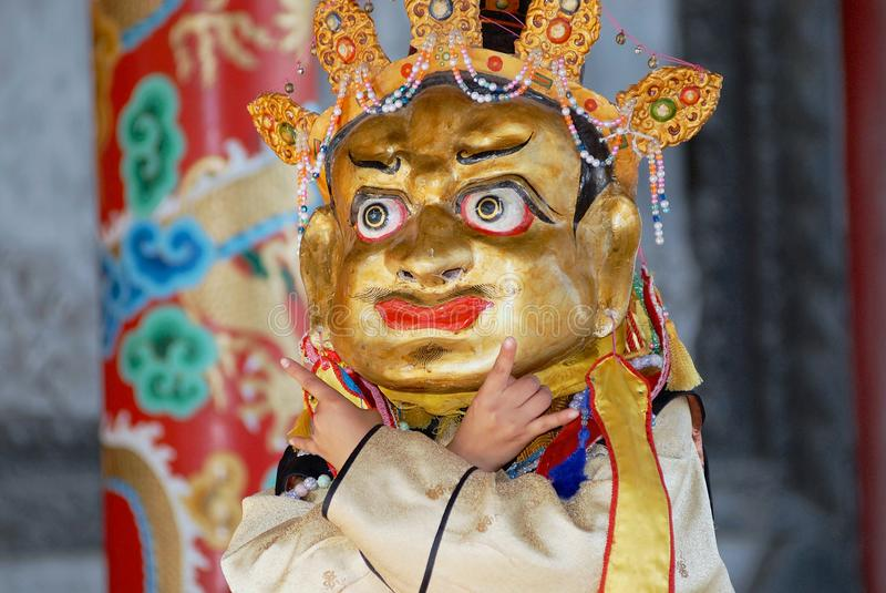 Man demonstrates traditional shaman`s mask and costume in Ulaanbaatar, Mongolia. royalty free stock photo