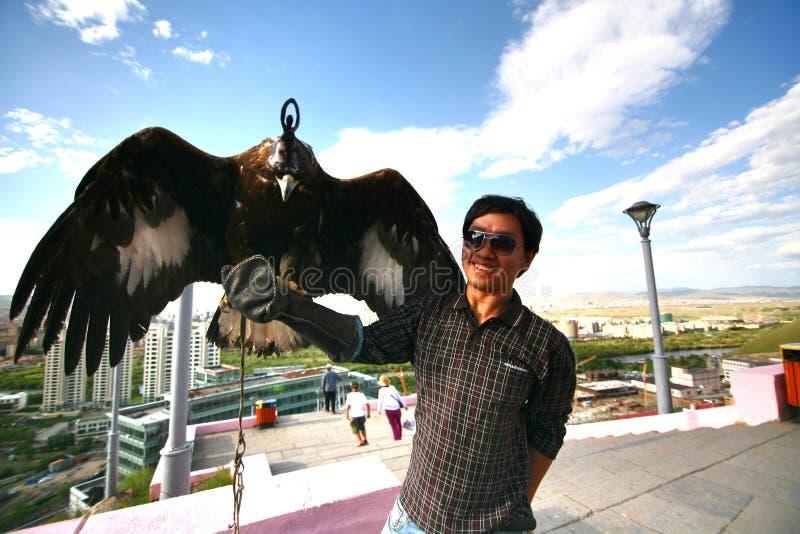 Ulaanbaatar Mongolia July 3 ,2016 - The man catch a Hawk at Zaisan Memorial royalty free stock images