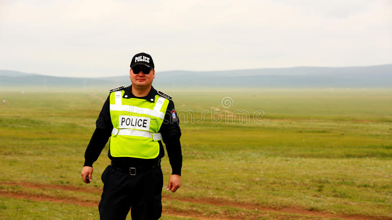 ULAANBAATAR, MONGOLIA - JULY 2013: Police officer at mongolian grassland stock photos
