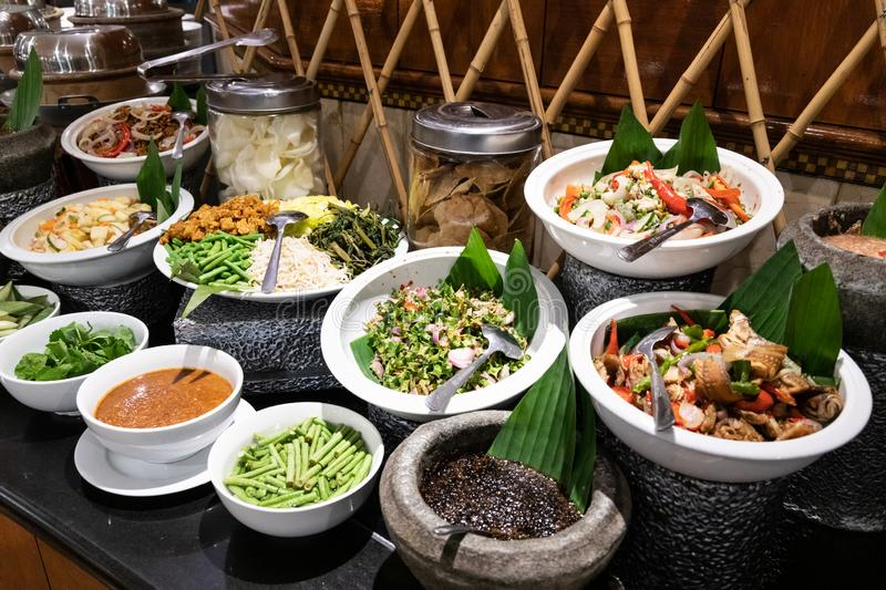 Ulam, traditional Malay food of raw vegetable with chili dipping. Spread of Ulam, traditional Malay food of raw vegetable with chili dipping stock images