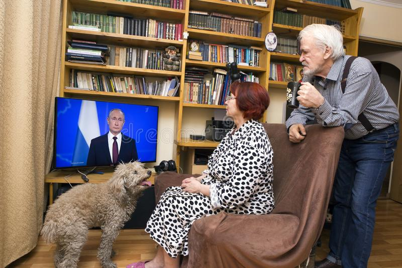 Message to the Parliament of the Russian President. ULAN - UDE, RUSSIA - February 20, 2019: a married couple of Russian pensioners at home are watching on TV the stock photos