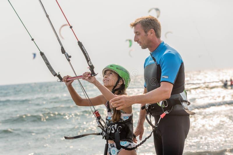 Little girl learning to kitesurf royalty free stock photos