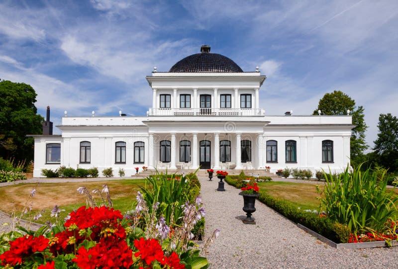 Ulefos Manor House Hovedgaard Ulefoss Telemark Norway. ULEFOSS, NORWAY - JULY 18, 2018: Facade of Empire-style Ulefos Manor House Hovedgaard, a popular tourist royalty free stock photos
