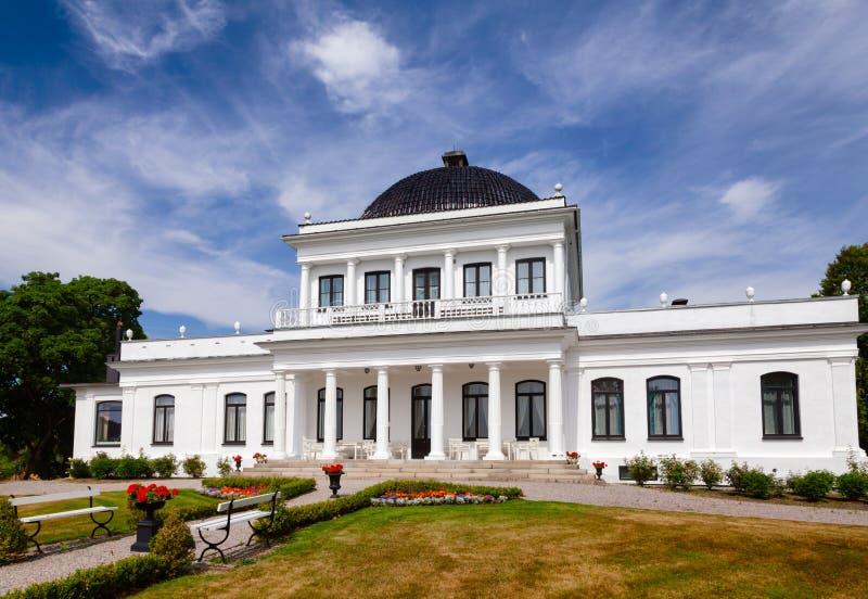 Ulefos Manor House Hovedgaard Ulefoss Telemark Norway. ULEFOSS, NORWAY - JULY 18, 2018: Facade of Empire-style Ulefos Manor House Hovedgaard, a popular tourist stock images