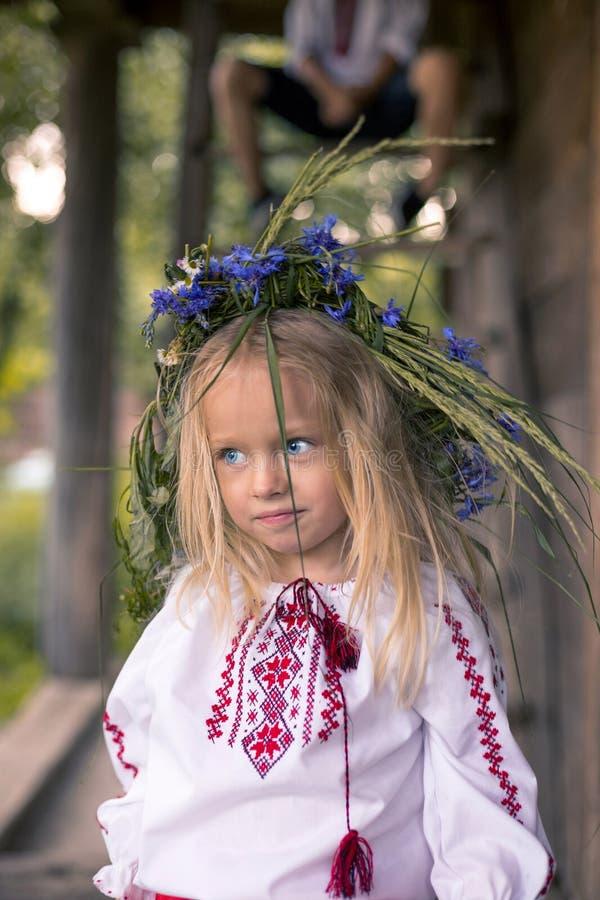 Little Ukrainian Girl In Circlet Of Blue Flowers Stock Photo