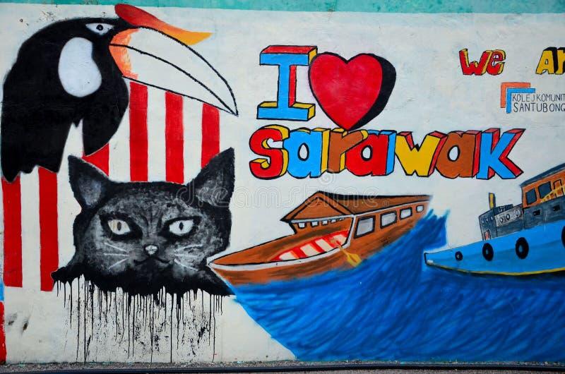 Uliczni sztuka graffiti z kot dzioborożec łodziami & ptakiem kocham Sarawak Kuching Malezja zdjęcia stock