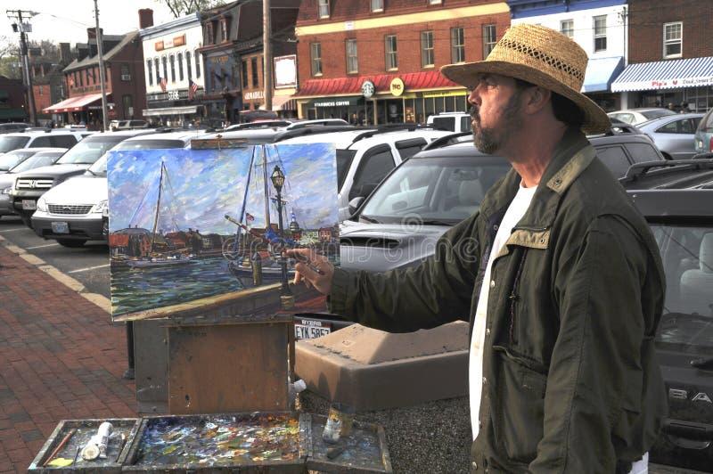 Uliczny artysta maluje obrazek obraz stock