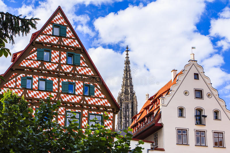 Ulm, Germany. Half-timbered houses in Ulm, Germany, on the banks of the Danube, with the spire of the cathedral in the middle royalty free stock photo