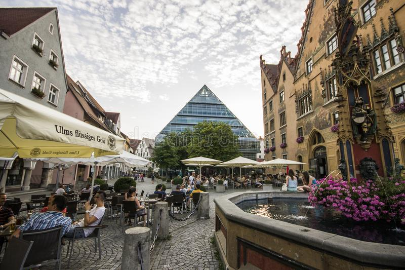 Ulm, Germany. Views of Ulm Marktplatz market square with the Rathaus town hall, right and Stadtbibliothek Public Library, center stock photography