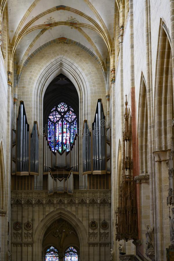 Ulm Minster,  Ulm Cathedral, insideview to organ and colorful window stock images