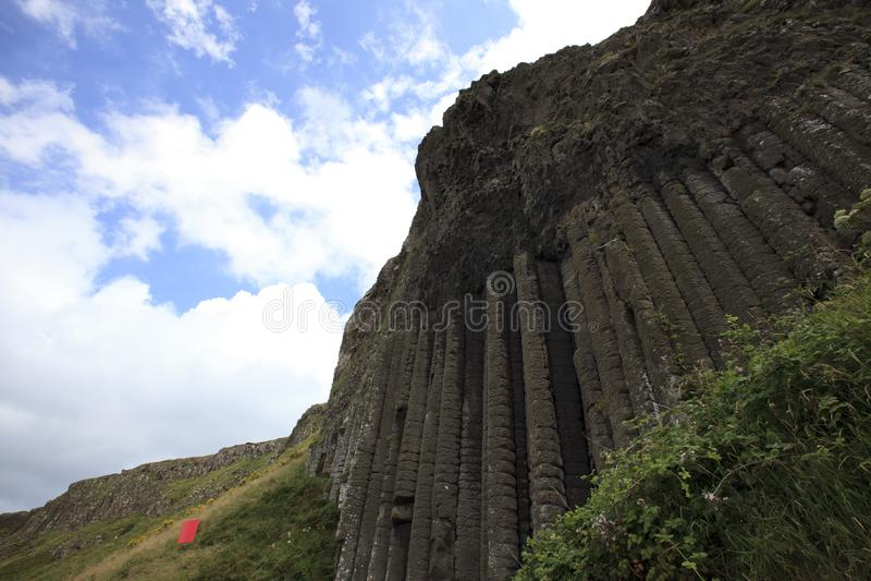 Polygonal basalt lava rock columns of the Giant`s Causeway. Ulster Ireland, - July 20, 2016: Polygonal basalt lava rock columns of the Giant`s Causeway on the stock photo