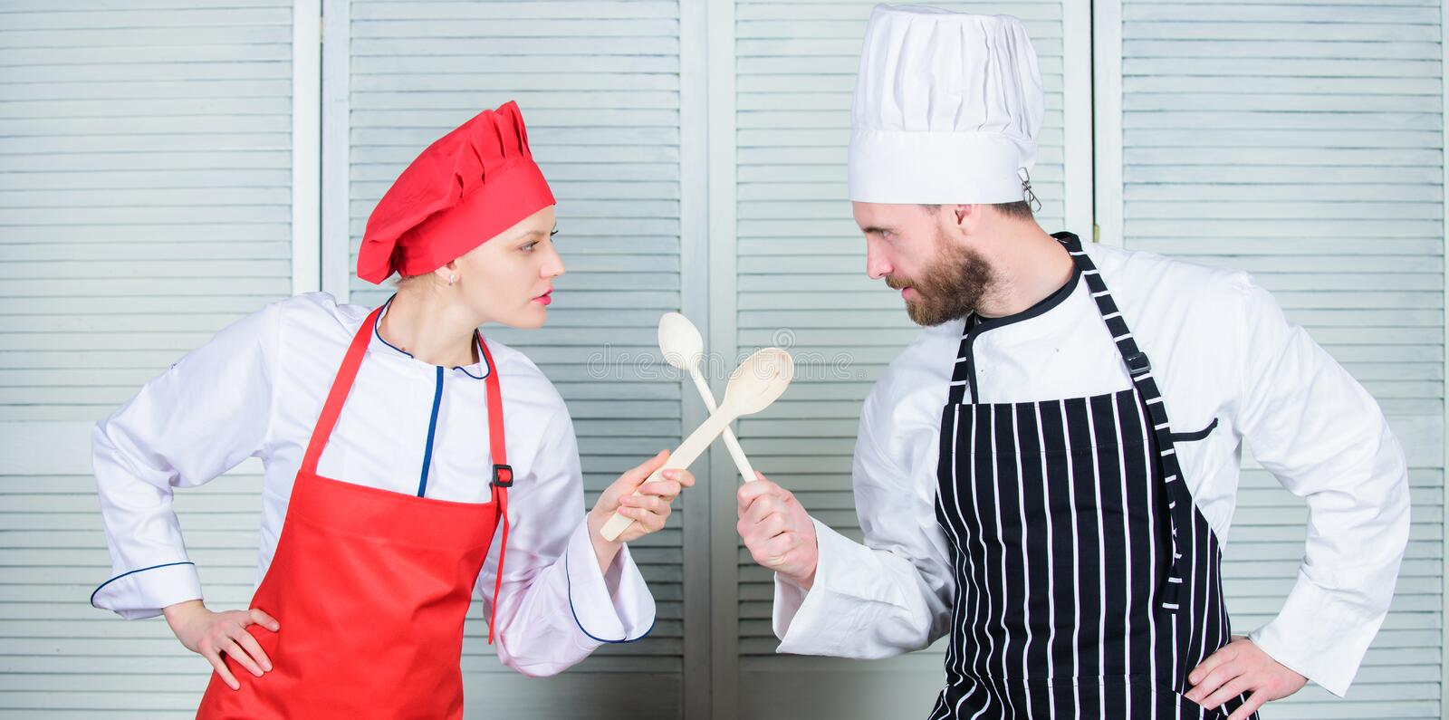 Ultimate cooking challenge. Culinary battle of two chefs. Couple compete in culinary arts. Kitchen rules. Culinary. Battle concept. Woman and bearded men stock image