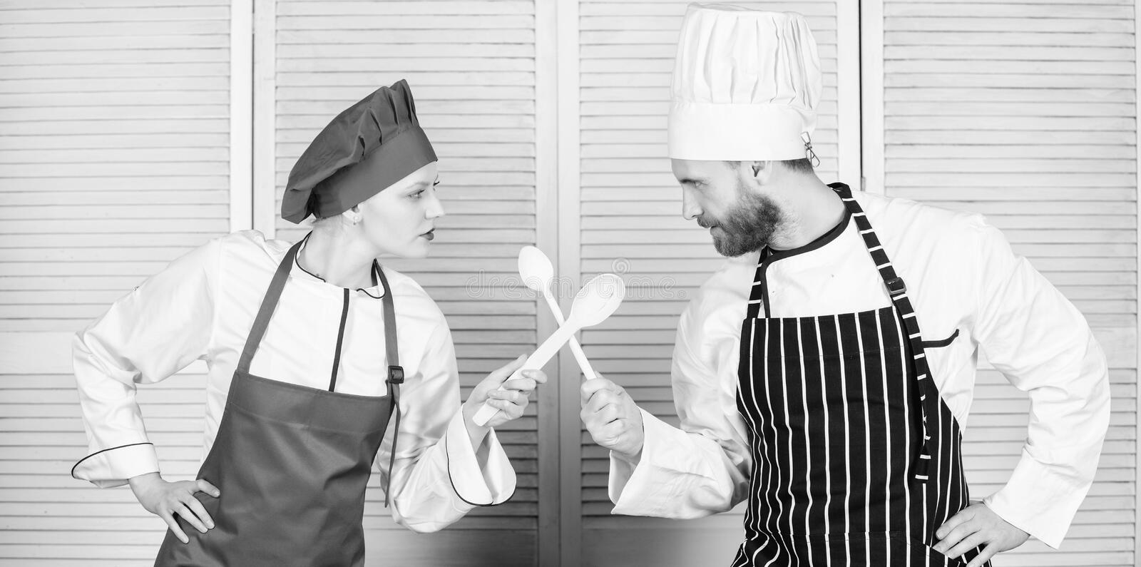 Ultimate cooking challenge. Culinary battle of two chefs. Couple compete in culinary arts. Kitchen rules. Culinary. Battle concept. Woman and bearded man stock photos