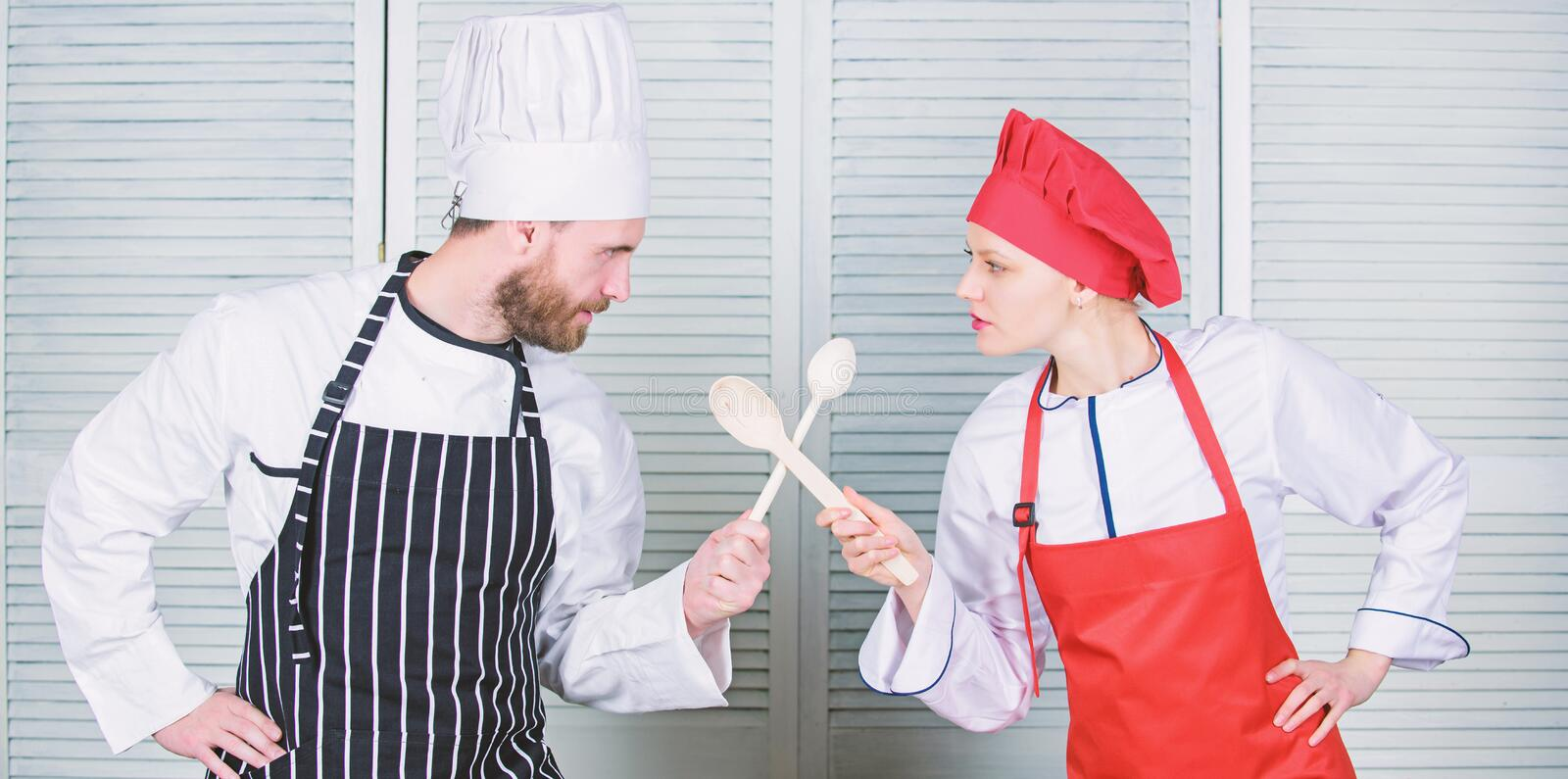 Ultimate cooking challenge. Culinary battle of two chefs. Couple compete in culinary arts. Kitchen rules. Culinary. Battle concept. Woman and bearded men stock photos