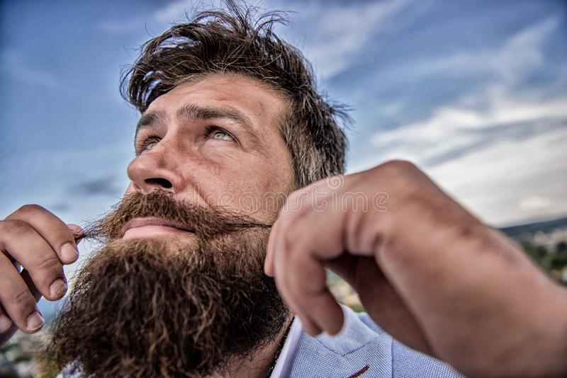 Ultimate moustache grooming guide. Hipster handsome attractive guy close up. Expert tips for growing and maintaining stock photo