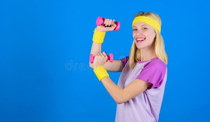 Ultimate upper body workout for women. Fitness instructor hold little dumbbell blue background. Fitness concept. Girl. Fitness instructor hold little dumbbell royalty free stock photos