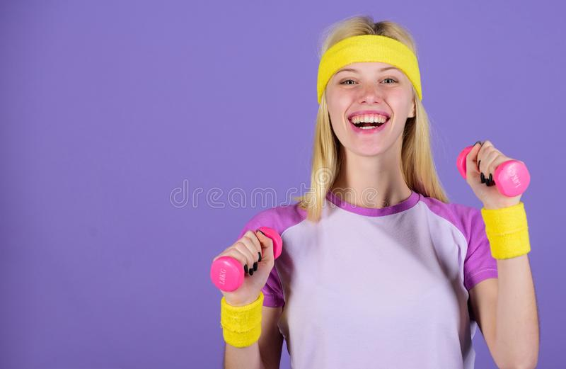 Ultimate upper body workout for women. Girl hold dumbbells wear bright wristbands. Vintage sport concept. Woman. Exercising with dumbbells. Easy exercises with royalty free stock photography