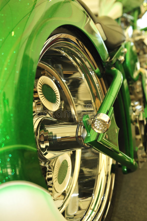 Ultra clean bike. Detail of the reflections at the chromed wheel royalty free stock image