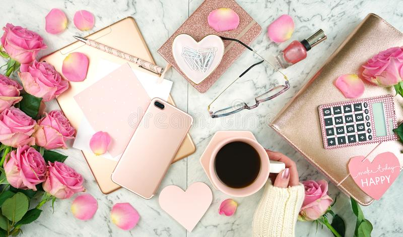 Ultra feminine pink desk workspace with rose gold accessories flatlay. royalty free stock photos
