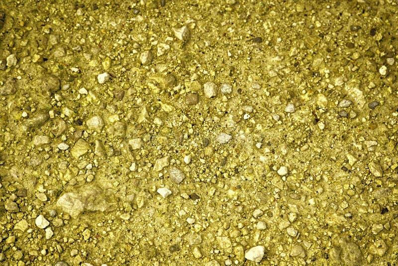 Ultra gele Grondtextuur, zandoppervlakte, steenachtergrond stock fotografie