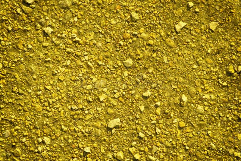 Ultra gele Grondtextuur, zandoppervlakte, steenachtergrond, goed voor ontwerpelement royalty-vrije stock fotografie