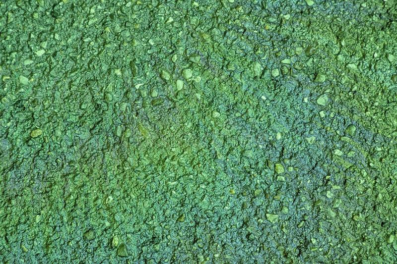 Ultra green Oil spill on asphalt road, abstract background or texture foe web site or mobile devices.  royalty free stock photography