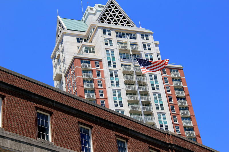 Ultra-modern architecture with American flag waving proudly in front of it stock images