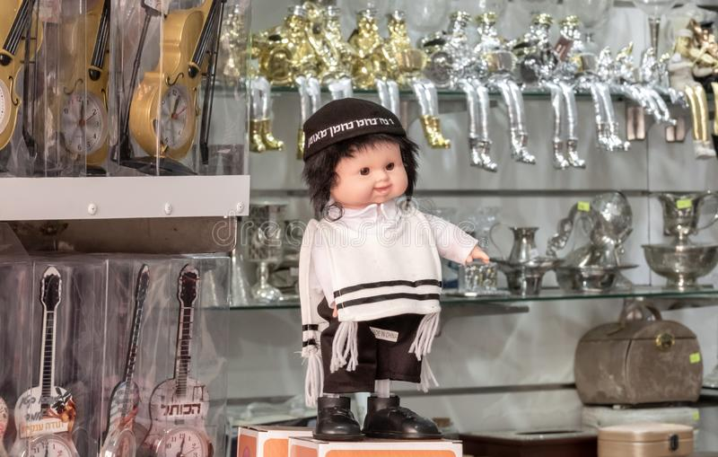Ultra-orthodox jewish boy doll for sale at an judaica store royalty free stock images