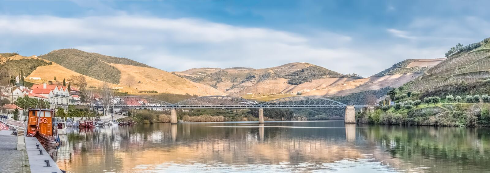 Ultra panoramic view of river Douro with downtown of Pinhao and marina with recreational boats and leisure for tourism, Port wine. Pinhao / Portugal - 04 16 2019 royalty free stock photo
