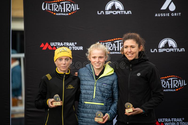 Ultra-Trail Australia UTA11 race. All place holders in the women`s event on the podium. Blue Mountains, Australia - April 16 2019: Ultra-Trail Australia UTA11 royalty free stock photos