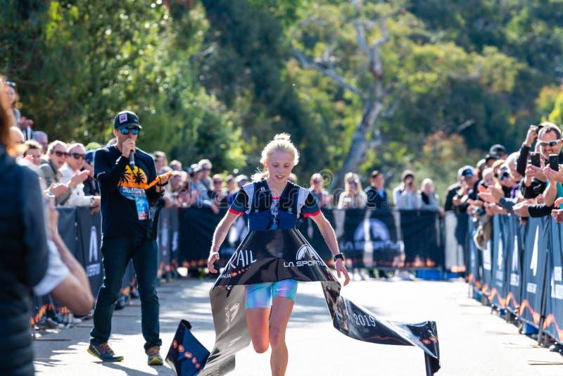 Ultra-Trail Australia UTA11 race. Runner Paige Penrose, overall winner of womens event, at the finish line. Blue Mountains, Australia - April 16 2019: Ultra stock photography