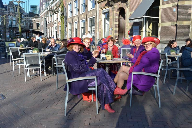 Ultra violet coats of Red Hat Society members royalty free stock photography