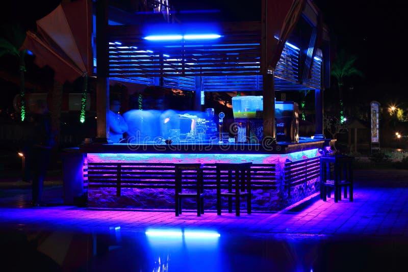 Ultra violet light is inviting night bar. Ultra violet beckoning night bar light. Alcohol bar on the summer area. A fascinating light