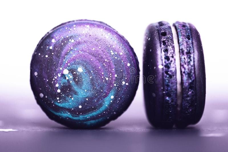 Ultra Violet macarons with space pattern. Couple of Ultra Violet macaroos with space pattern, macro. Color of the year 2018 royalty free stock photography