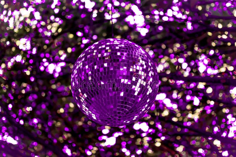 Abstract Ultra Violet Disco Ball. An Ultra violet, purple disco ball reflecting it`s purple colors onto the background forming an abstract photograph stock photography