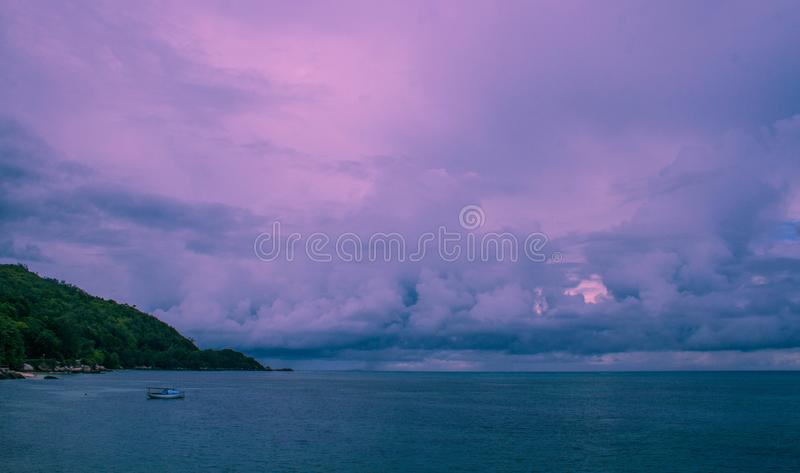 Ultra-violet storm clouds over the ocean royalty free stock images