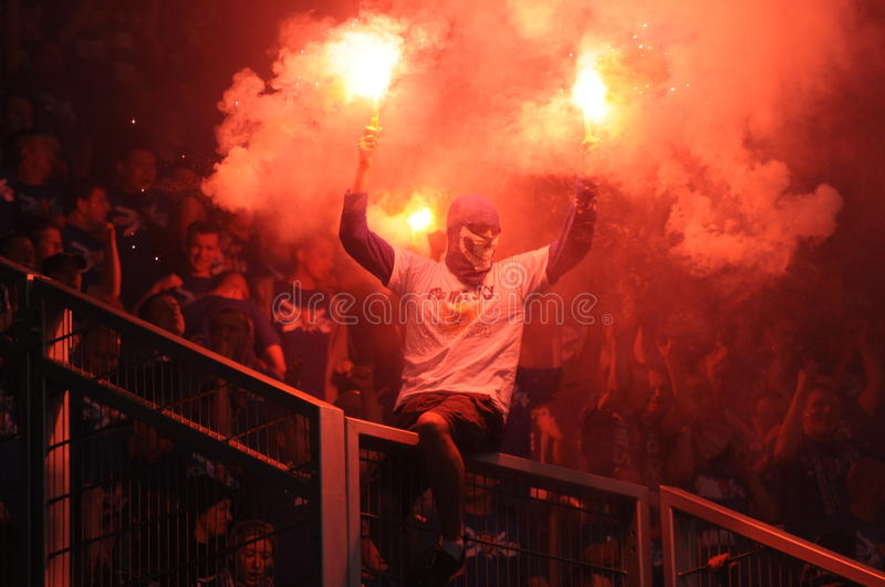 Download Ultras Hooligans Supporters Burn Flares During Match, Slask Wroclaw Vs Lech Poznan On May 06, 2013 In Wroclaw, Pola Editorial Photography - Image: 32406392