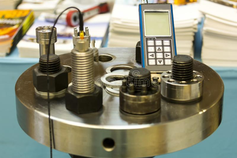 Ultrasonic bolt load measurement maintenance testing device for industrial work.  stock photo