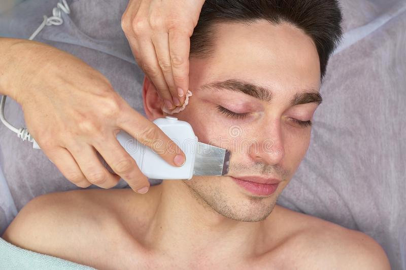 Ultrasonic face cleaning top view. stock photos