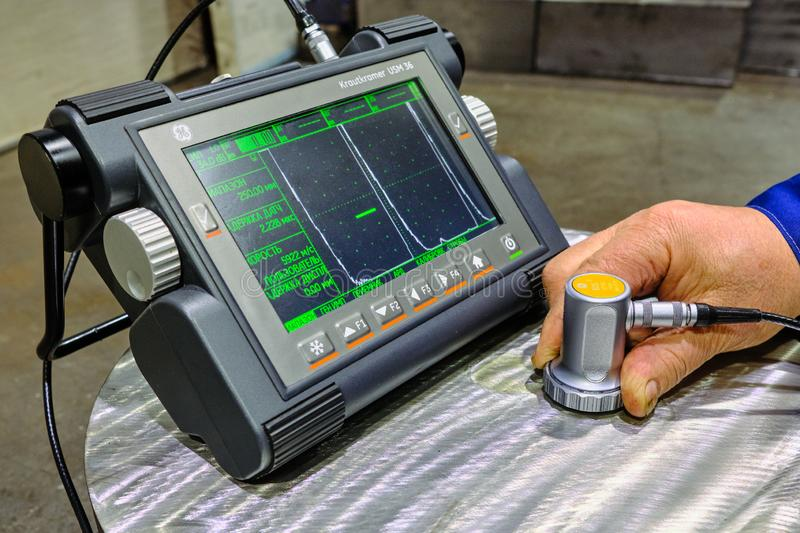 Ultrasonic flaw detector krautkramer USM 36 at the plant during accurate measurement of steel thickness. Sankt Petersburg, Russia - February 15, 2019: Ultrasonic royalty free stock photography