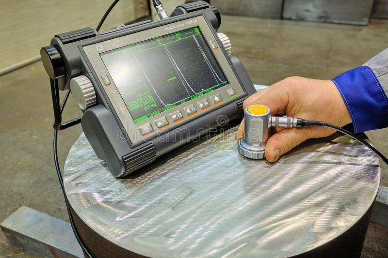 Ultrasonic flaw detector krautkramer USM 36 at the plant during accurate measurement of steel thickness. Sankt Petersburg, Russia - February 15, 2019: Ultrasonic stock images