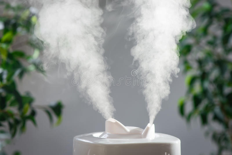 Ultrasonic humidifier in the house. Humidification royalty free stock photography