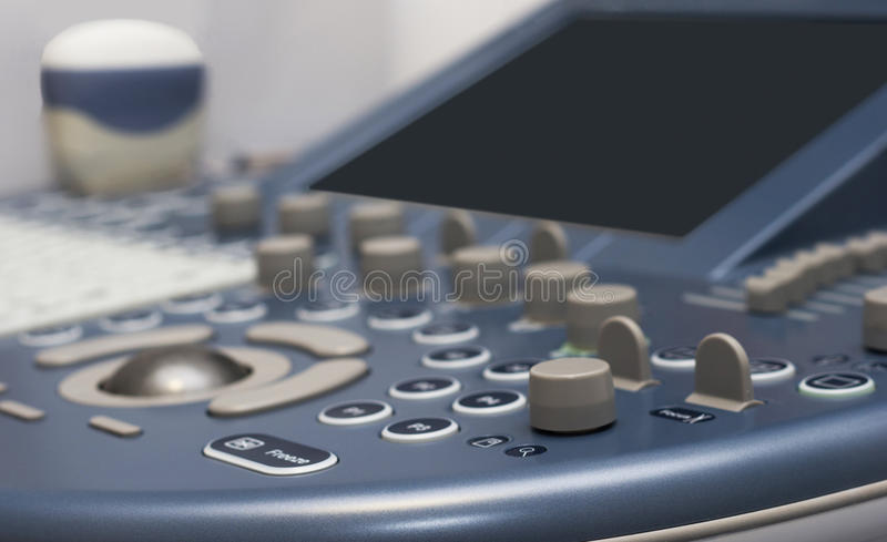 Ultrasound. Detail of ultrasound control buttons with ultrasound probe on background royalty free stock photos