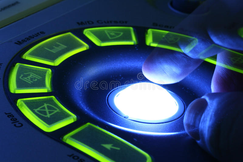 Ultrasound machine. Close-up of hand on the control panel of ultrasound machine stock photos