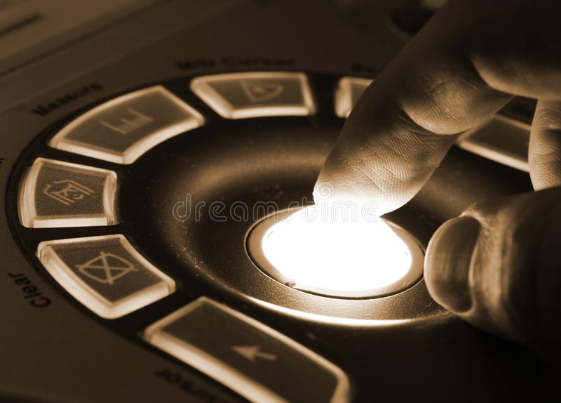 Ultrasound machine. Close-up of doctor hand on the control panel of ultrasound machine stock photo