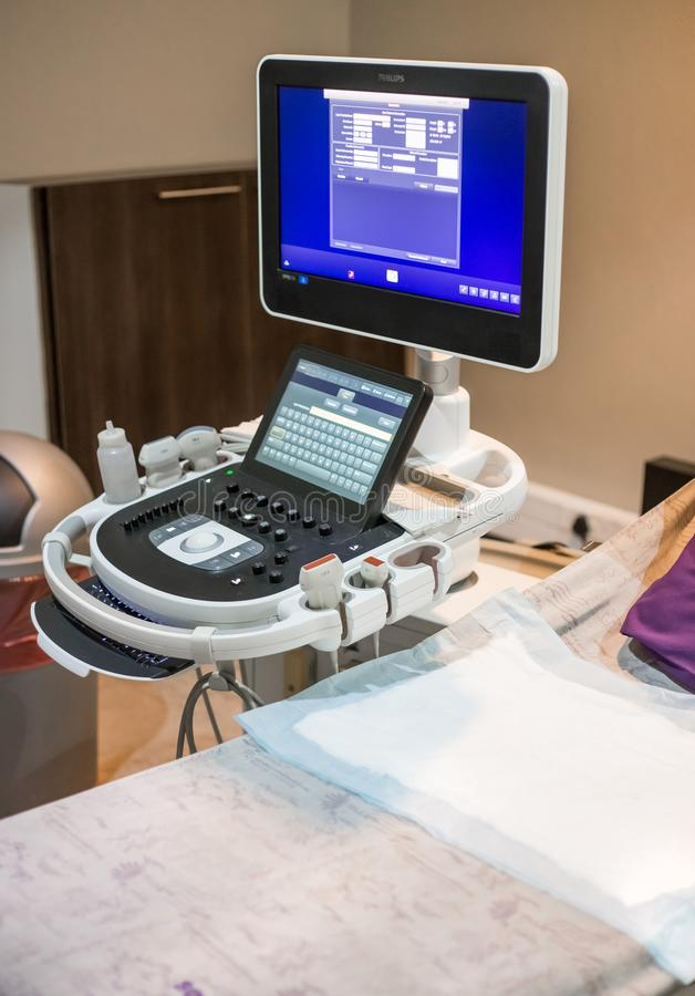 Ultrasound machine and bed in clinic room. royalty free stock image